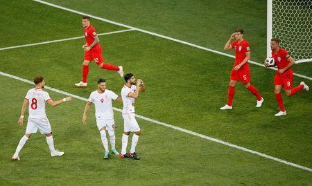 Soccer Football - World Cup - Group G - Tunisia vs England - Volgograd Arena, Volgograd, Russia - June 18, 2018 Tunisia's Ferjani Sassi celebrates scoring their first goal as England's Jordan Henderson, John Stones and Kieran Trippier react REUTERS/Gleb Garanich