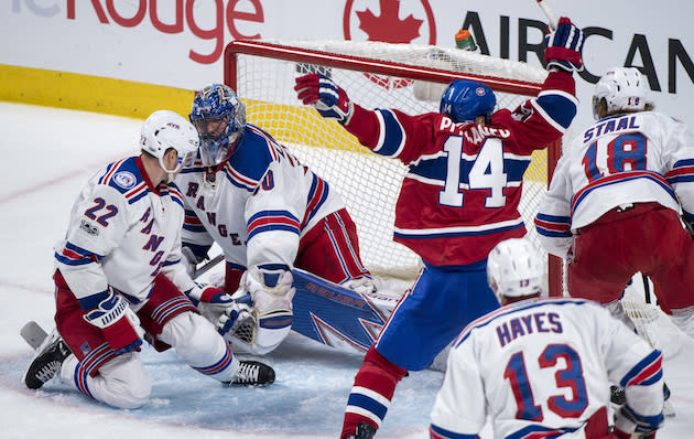 """<a class=""""link rapid-noclick-resp"""" href=""""/nhl/teams/mon/"""" data-ylk=""""slk:Montreal Canadiens"""">Montreal Canadiens</a>' <a class=""""link rapid-noclick-resp"""" href=""""/nhl/players/3005/"""" data-ylk=""""slk:Tomas Plekanec"""">Tomas Plekanec</a> celebrates his goal past <a class=""""link rapid-noclick-resp"""" href=""""/nhl/teams/nyr/"""" data-ylk=""""slk:New York Rangers"""">New York Rangers</a> goaltender <a class=""""link rapid-noclick-resp"""" href=""""/nhl/players/2645/"""" data-ylk=""""slk:Henrik Lundqvist"""">Henrik Lundqvist</a> as Rangers' defenseman <a class=""""link rapid-noclick-resp"""" href=""""/nhl/players/4386/"""" data-ylk=""""slk:Nick Holden"""">Nick Holden</a> (22) looks on during third-period Game 2 NHL Stanley Cup first-round playoff hockey game action Friday, April 14, 2017, in Montreal. (Paul Chiasson/The Canadian Press via AP)"""