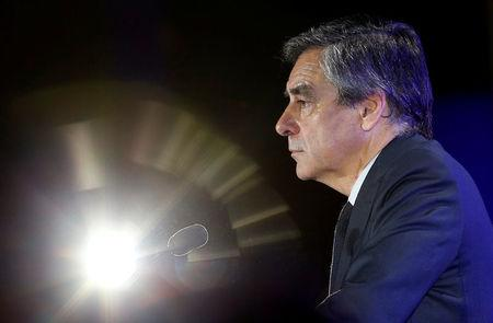 Francois Fillon, former French prime minister, member of the Republicans political party and 2017 presidential election candidate of the French centre-right, attends a political rally in Nimes, France March 2, 2017. REUTERS/Jean-Paul Pelissier