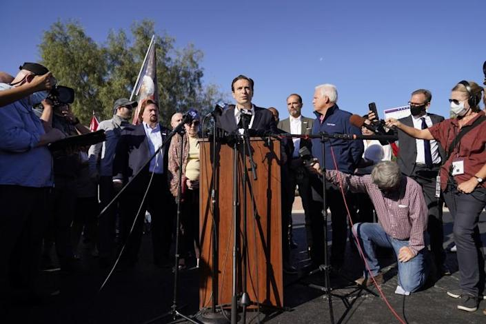 Former Nevada Attorney General Adam Laxalt speaks during a news conference in front of the Clark County Election Department, Thursday, Nov. 5, 2020, in Las Vegas. (AP Photo/John Locher)