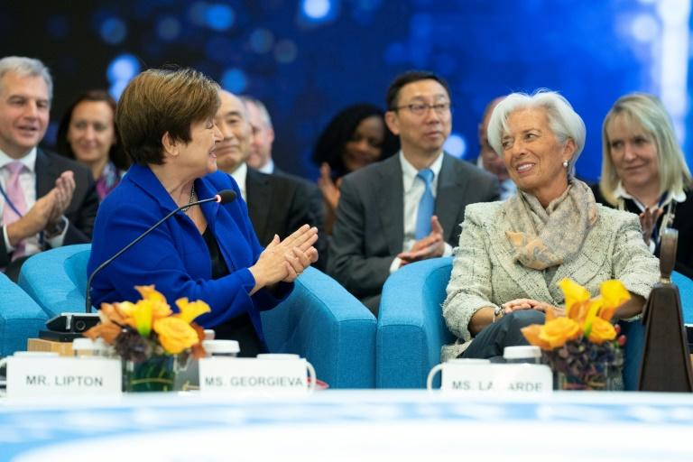 IMF chief Kristalina Georgieva applauds her predecessor Christine Lagarde, who will take over as head of the European Central Bank, in this image released by the International Monetary Fund (AFP Photo/Stephen JAFFE)
