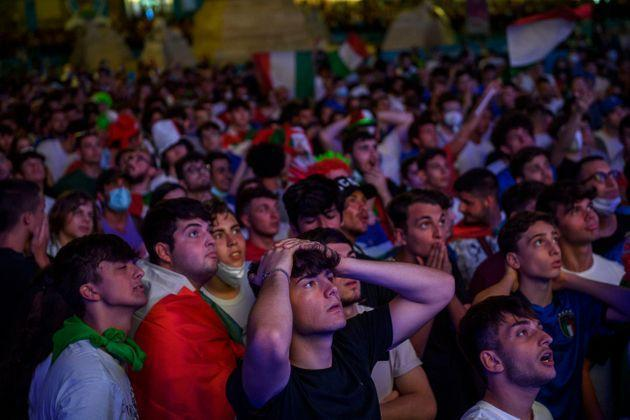 ROME, ITALY - JULY 02: Italian fans react as they watch on giant screens at Piazza del Popolo fan zone the Euro 2020 Quarter Final match between Belgium and Italy played at the at Fussball Arena Muenchen, on July 2, 2021 in Rome, Italy. The winner of this match heads to the UEFA European Football Championship's semi-final match. The tournament was postponed from last year due to the Covid-19 pandemic. (Photo by Antonio Masiello/Getty Images) (Photo: Antonio Masiello via Getty Images)