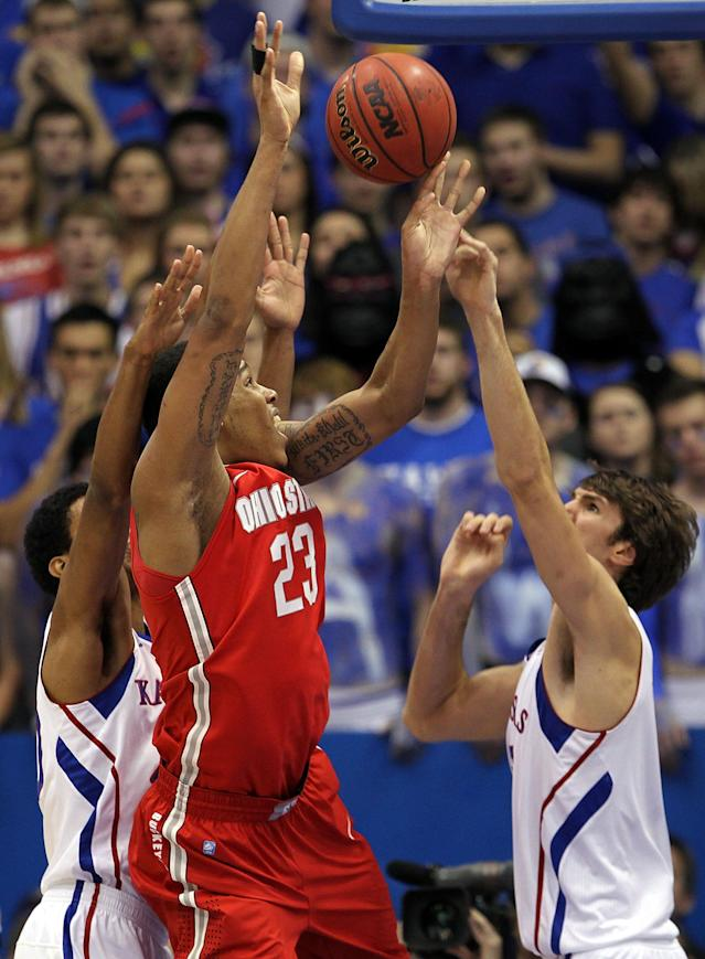LAWRENCE, KS - DECEMBER 10: Jeff Withey #5 of the Kansas Jayhawks blocks a shot by Amir Williams #23 of the Ohio State Buckeyes during the game on December 10, 2011 at Allen Fieldhouse in Lawrence, Kansas. (Photo by Jamie Squire/Getty Images)