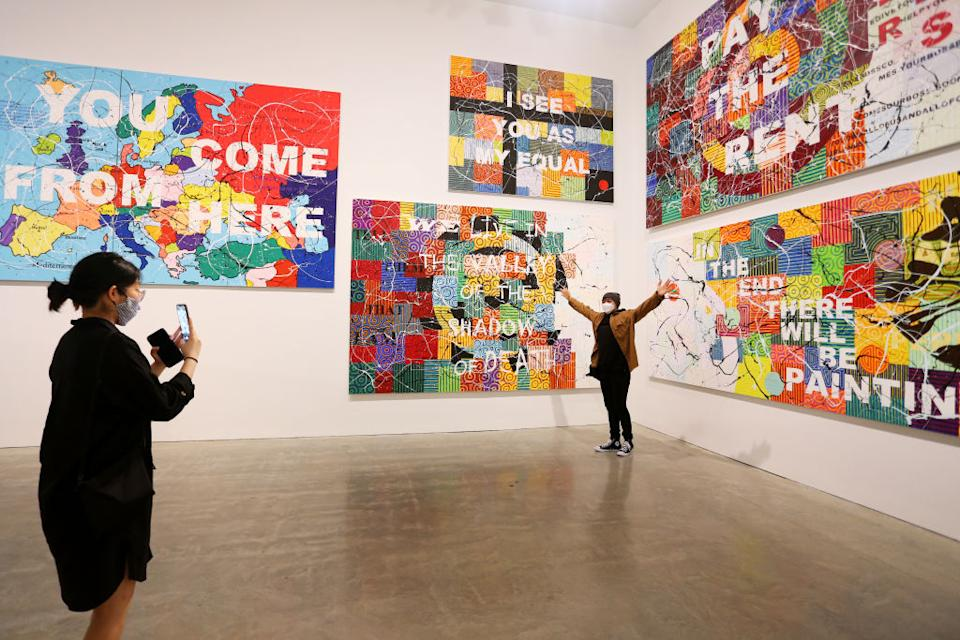 Patrons take in the work of artist Richard Bell at the MCA (Museum of Contemporary Art Australia) in Sydney, Australia.