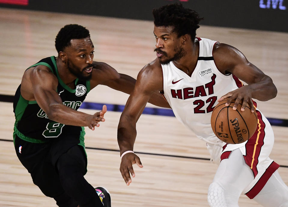 Jimmy Butler #22 of the Miami Heat drives the ball against Kemba Walker #8 of the Boston Celtics during the fourth quarter in Game One of the Eastern Conference Finals