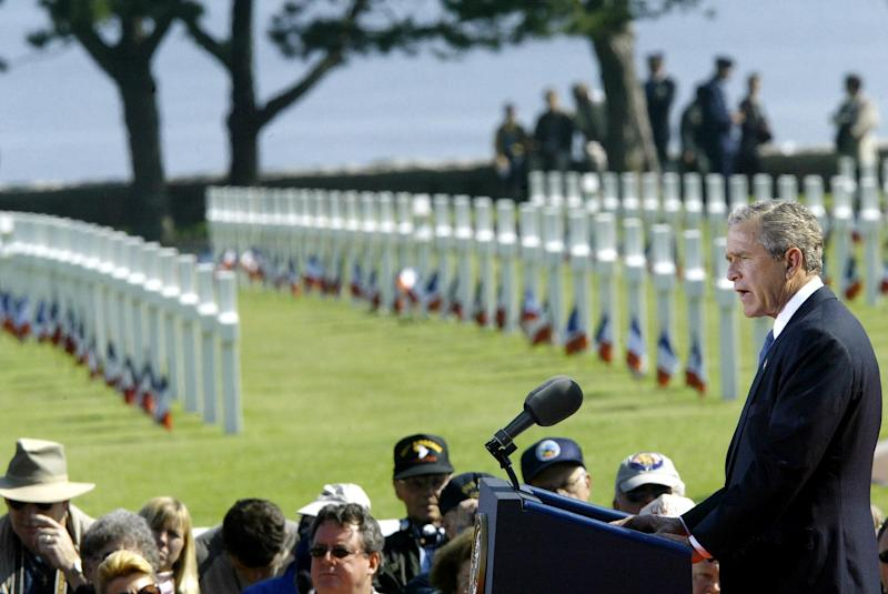 President George W. Bush delivers a speech during ceremonies on June 6, 2004, at the American cemetery in Colleville-sur-Mer, France, during the 60th anniversary of the D-Day invasion on Omaha Beach.