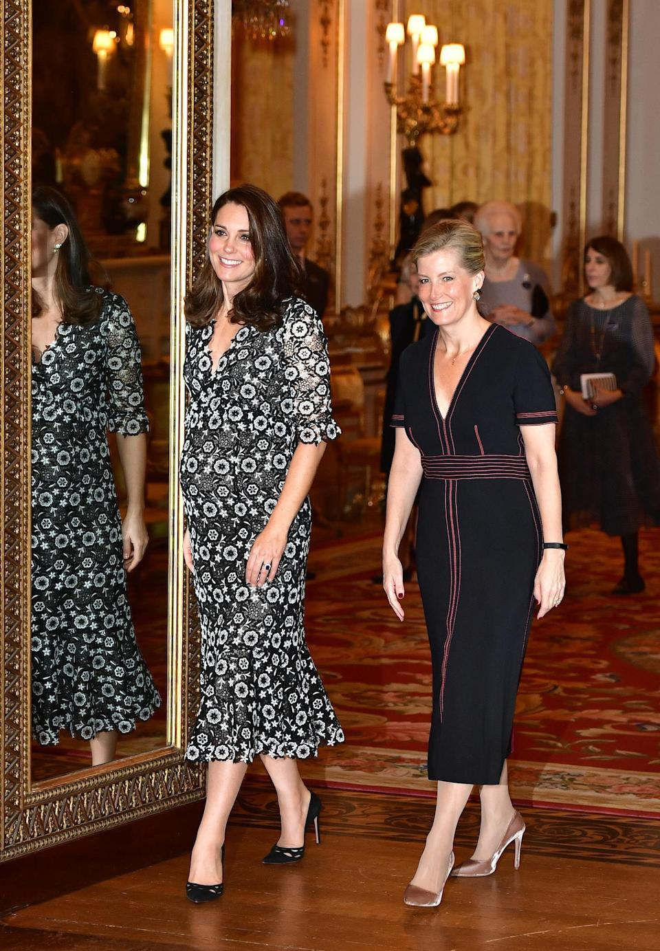 <p>Kate Middleton wears a dark floral dress by Erdem at a fashion reception at Buckingham Palace alongside Sophie, Countess of Wessex. (Photo: Getty Images) </p>
