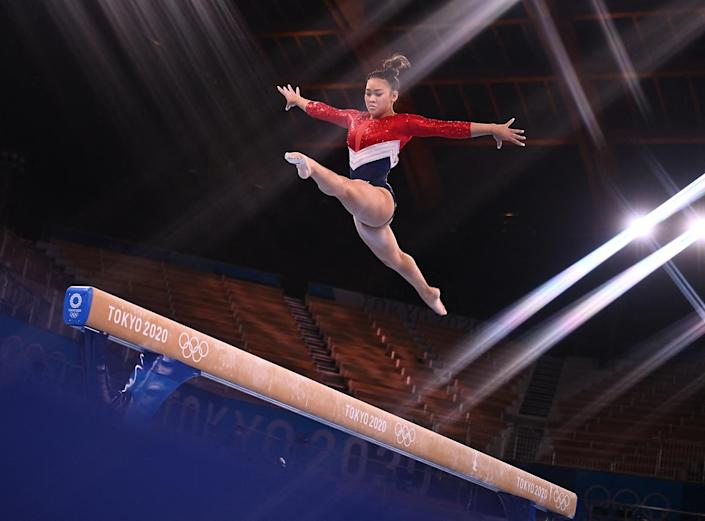 <p>Team USA's Sunisa Lee competes in the balance beam event of the artistic gymnastics women's team final; though Simone Biles withdrew from the competition, Lee and her teammates finished with the silver medal.</p>