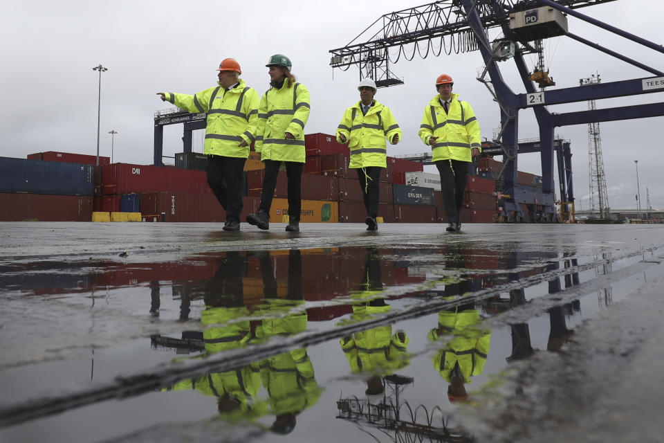 Britain's prime minister Boris Johnson, left, and chancellor of the exchequer Rishi Sunak, second right, walk past shipping containers during a visit to Teesport in Middlesbrough, England, on 4 March. Photo: Scott Heppell/AP