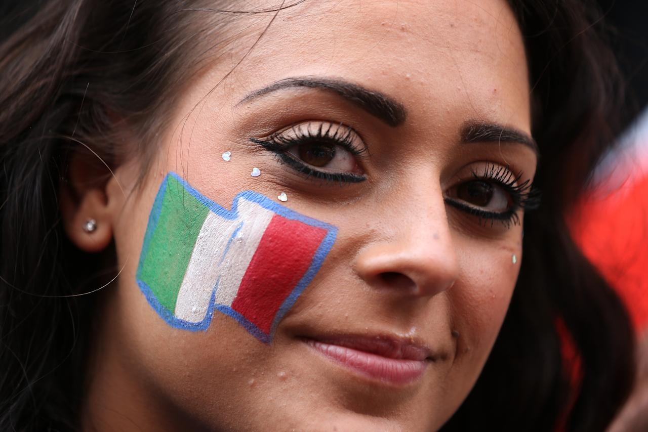 LONDON, ENGLAND - JULY 01:  Football fan Alex Nicas poses outside the Little Italy bar with the Italian national flag painted on her cheek ahead of the screening of the UEFA EURO 2012 final football match between Spain and Italy, taking place at the Olympic Stadium in Kiev, Ukraine on July 1, 2012 in London, England. London's large Spanish and Italian communities are watching the final.  (Photo by Peter Macdiarmid/Getty Images)