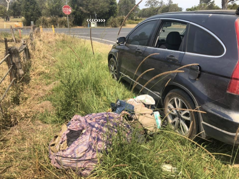 Some of the man's belongings were strewn across the side of the road next to his black car near Mullumbimby in NSW's north.