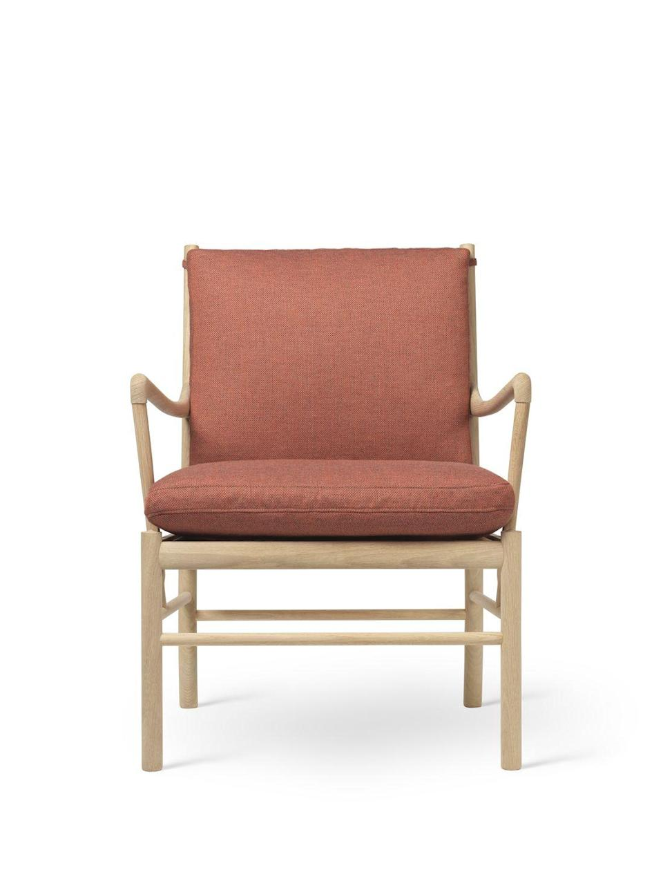 """<p>Created by Danish minimalist Ole Wanscher for Carl Hansen & Søn in 1949, the 'Colonial' chair strikes a careful balance between traditional and modernity, and luxury and restraint. Although seemingly simple and pared-back, slender, carved arms and a choice of refined fabrics –including butter-soft leather – provide a tactile experience for the sitter. From £1,819, <a href=""""https://www.carlhansen.com/en"""" rel=""""nofollow noopener"""" target=""""_blank"""" data-ylk=""""slk:carlhansen.com"""" class=""""link rapid-noclick-resp"""">carlhansen.com</a></p>"""