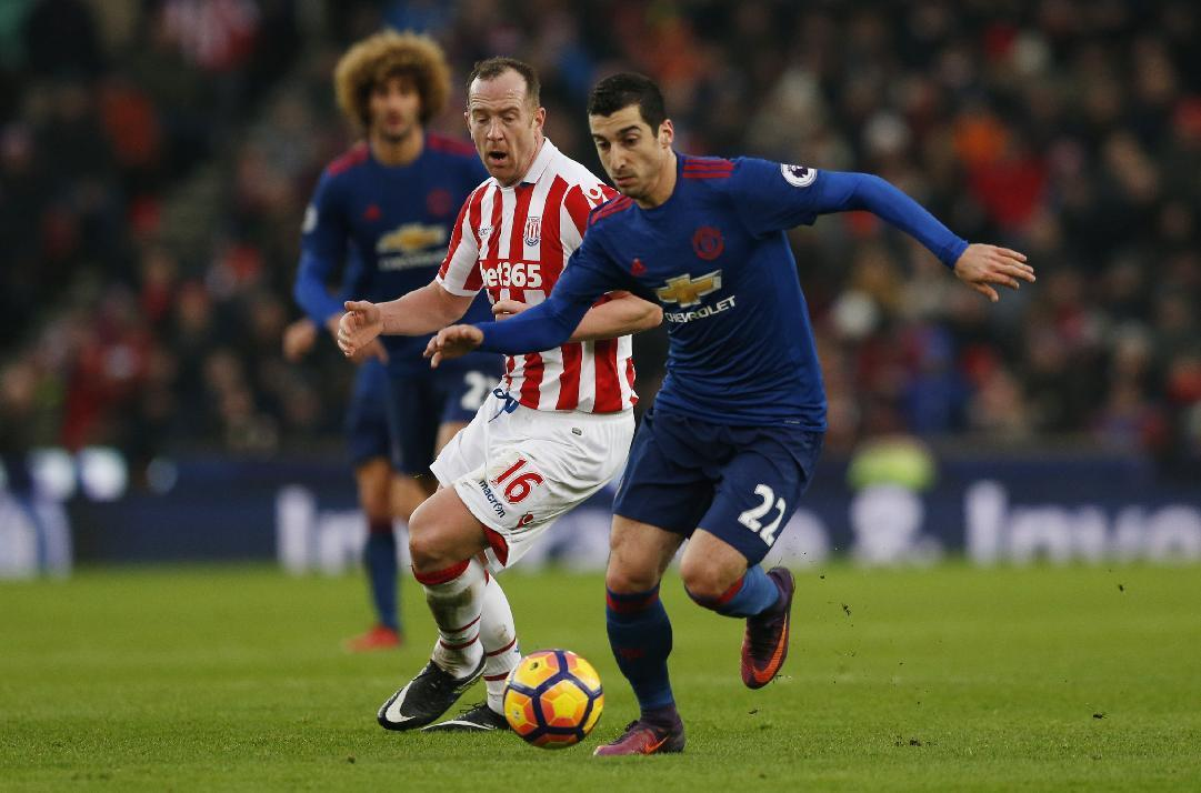 """Britain Soccer Football - Stoke City v Manchester United - Premier League - bet365 Stadium - 21/1/17 Manchester United's Henrikh Mkhitaryan in action with Stoke City's Charlie Adam  Action Images via Reuters / Andrew Boyers Livepic EDITORIAL USE ONLY. No use with unauthorized audio, video, data, fixture lists, club/league logos or """"live"""" services. Online in-match use limited to 45 images, no video emulation. No use in betting, games or single club/league/player publications.  Please contact your account representative for further details."""
