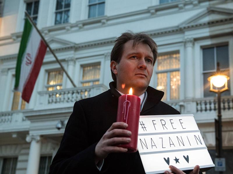 Richard Ratcliffe, husband of Nazanin Zaghari-Ratcliffe holds a '#Free Nazanin' sign and candle during a vigil for the British-Iranian mother (Getty)