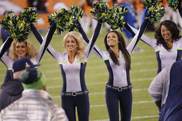 Seattle Seahawks cheerleaders perform before the NFL Super Bowl XLVIII football game against the Denver Broncos Sunday, Feb. 2, 2014, in East Rutherford, N.J. (AP Photo/Matt York)