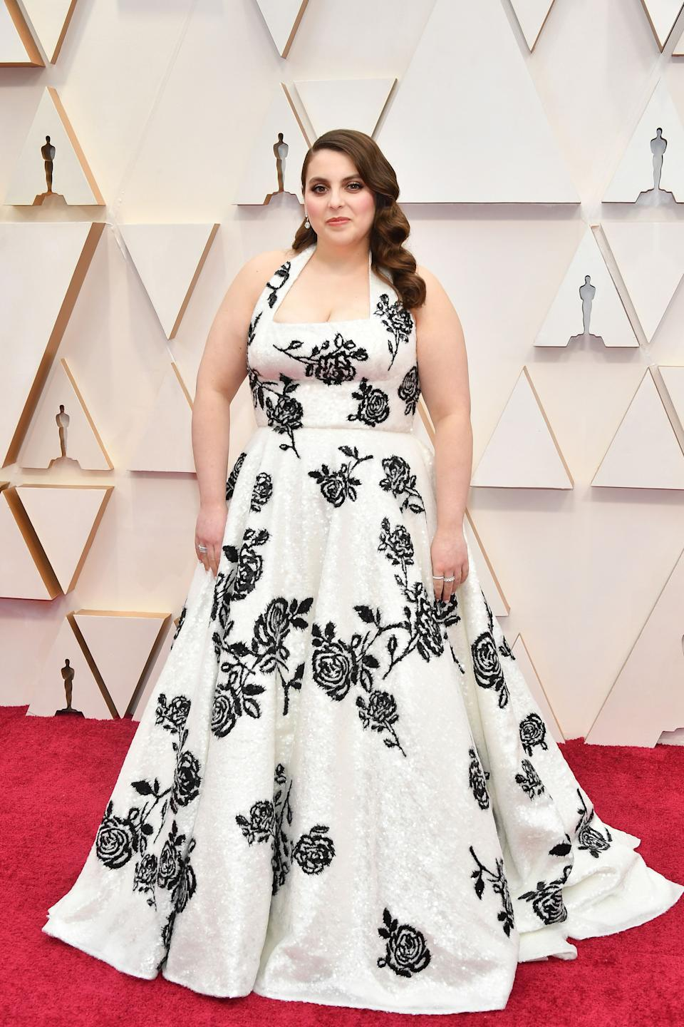 """The """"Booksmart"""" actress and Oscars presenter wore a custom monochrome gown by Miu Miu."""
