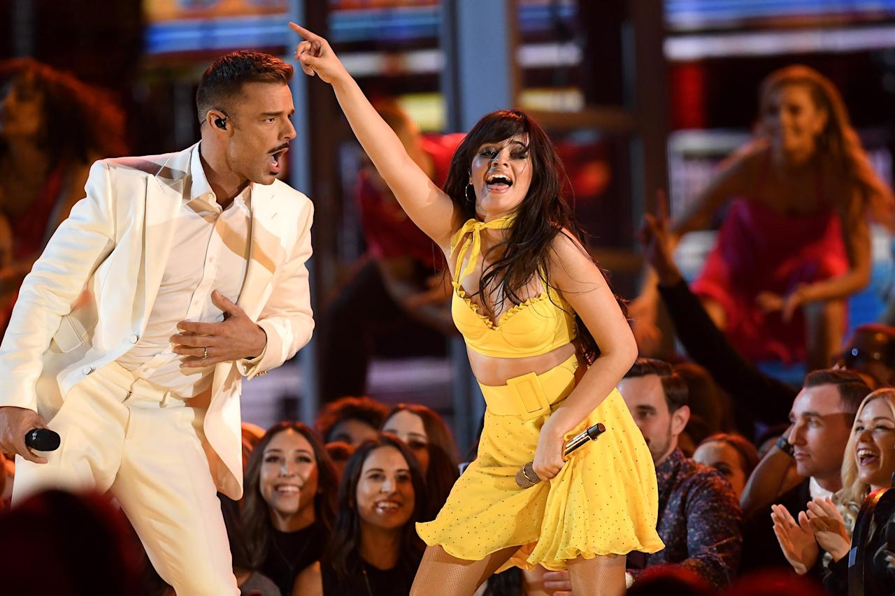 "The two-time nominee (and former Fifth Harmony member) proved her staying power on the mainstream scene with a fiery workout of a set that featured J Balvin, Ricky Martin, Arturo Sandoval, and Young Thug. Cabello told reporters on the Grammys red carpet the colorful ""Havana"" performance was inspired by her grandmother's life, and members of her real family appeared on stage during the production, which was dressed to resemble a bustling block party in the No. 1-charting song's titular Cuban city — which Martin, Sandoval, Young Thug, and Balvin promptly crashed."