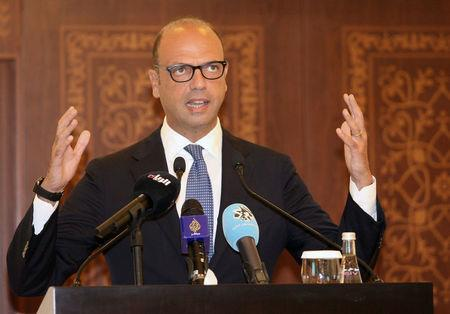 Italian foreign minister Angelino Alfano gestures during a joint news conference with Qatar's foreign minister Sheikh Mohammed bin Abdulrahman al-Thani in Doha, Qatar, August 2, 2017. REUTERS/Naseem Zeitoon
