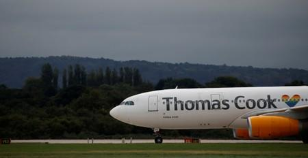 FILE PHOTO: A Thomas Cook Airbus A330 aircraft taxis across the tarmac at Manchester Airport in Manchester