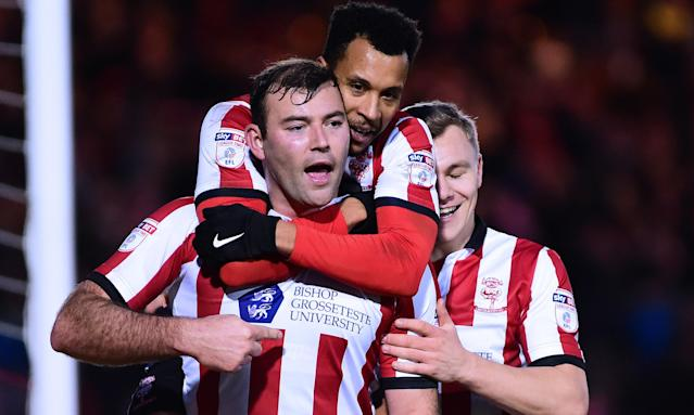 Lincoln City's Matt Rhead is congratulated after scoring his side's second goal in the win over Forest Green.