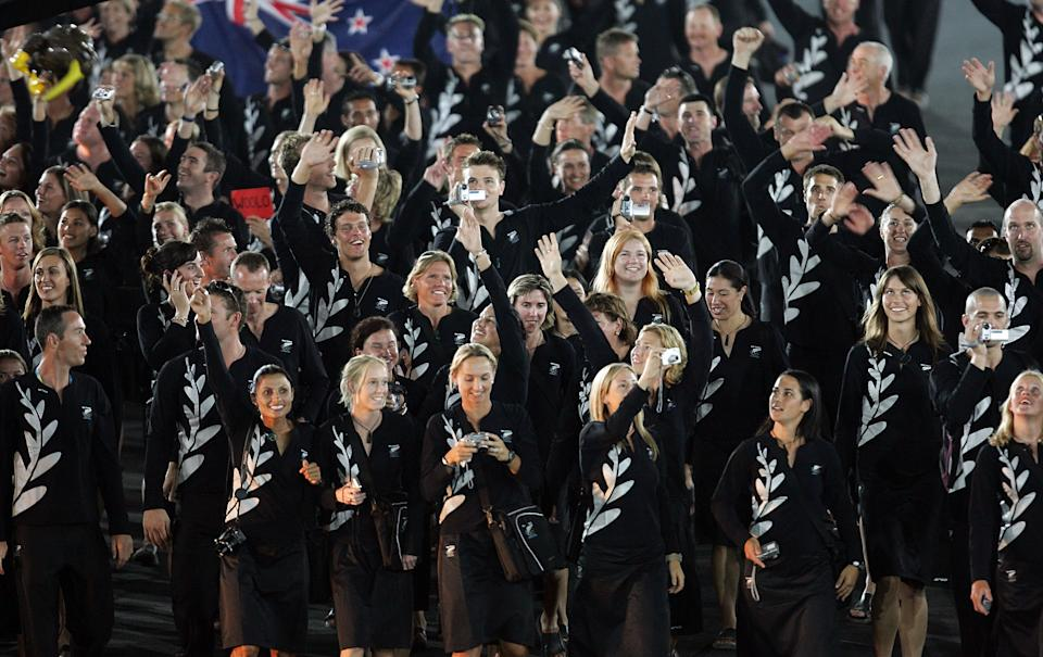ATHENS - AUGUST 13:  The delegation from New Zealand walk during the parade of nations, part of the opening ceremonies for the Athens 2004 Summer Olympic Games on August 13, 2004 at the Sports Complex Olympic Stadium in Athens, Greece.  (Photo by Stuart Franklin/Getty Images)
