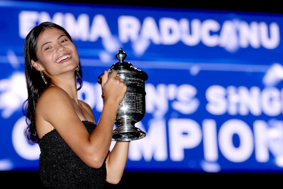 Seen here, Emma Raducanu poses with the trophy after winning the 2021 US Open title.