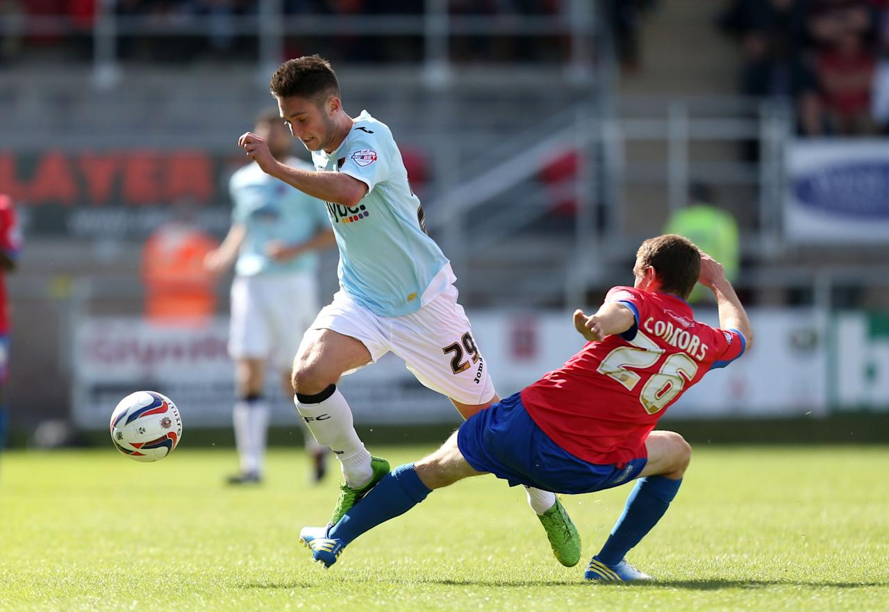 Dagenham & Redbridge's Jack Connors (right) tackles Exter City's Matt Grimes during the Sky Bet Football League Two match at the London Borough of Barking and Dagenham Stadium, London.