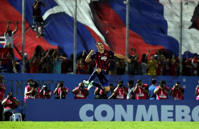 Soccer Football - Paraguay's Cerro Porteno v Uruguay's Defensor Sporting - Copa Libertadores - General Pablo Rojas Stadium, Asuncion, Paraguay - March 13, 2018- Diego Churin of Cerro Porteno celebrates his goal. REUTERS/Jorge Adorno