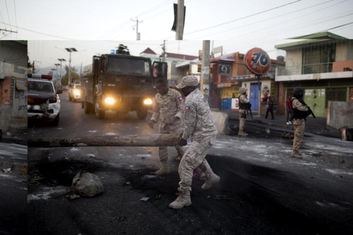 <p>National police officers remove a barricade in the street during a protest over the cost of fuel in Port-au-Prince, Haiti, Saturday, July 7, 2018. (Photo: Dieu Nalio Chery/AP) </p>