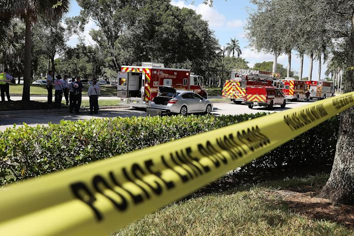 <p>Police tape keeps people back as the The Broward Sheriff's Office bomb squad deploys a robotic vehicle to investigate a suspicious package in the building where Rep. Debbie Wasserman Schultz (D-FL) has an offce on Oct. 24, 2018 in Sunrise, Fla. (Photo: Joe Raedle/Getty Images) </p>