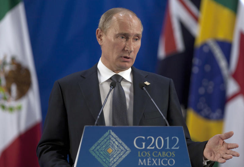 Russia's President Vladimir Putin speaks during a press conference at the G20 summit in Los Cabos, Mexico, Tuesday, June 19, 2012. (AP Photo/Esteban Felix)