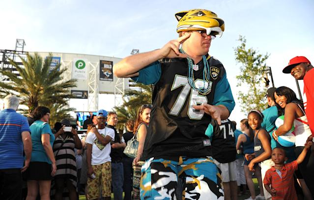 Jeremy Conn dances at the draft party wearing the jersey of Luke Joeckel the Jag's first pick in the 2013 draft. The Jacksonville Jaguars' 2014 NFL Draft Party was held at EverBank Field on Thursday May 8, 2014 Jacksonville, Florida. (AP Photo/Florida Times-Union/Bruce Lipsky)