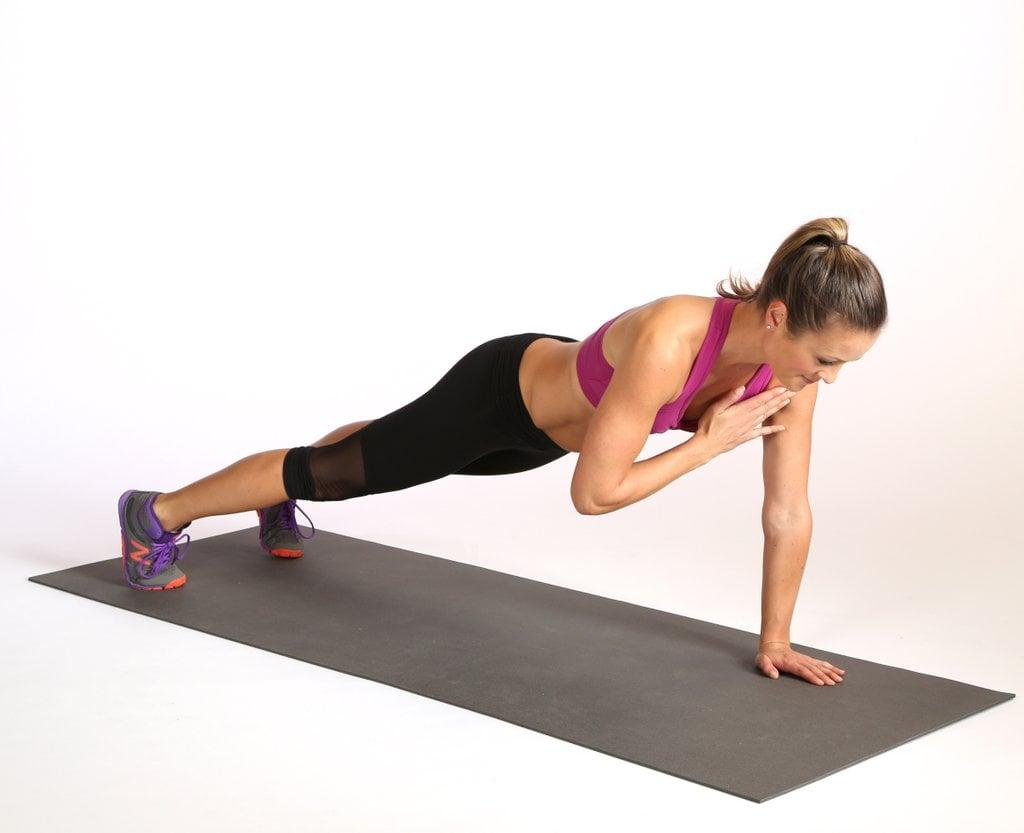 <ul> <li>Begin in a plank variation with your feet slightly wider than your hips for added stability.</li> <li>Keeping your torso stable, bring your right hand to your left shoulder, then return your right hand back to the mat.</li> <li>Bring your left hand to your right shoulder and return it to the mat.</li> <li>Next, drive your left knee to your left elbow. Return to the starting position and repeat on the right side. This counts as one rep.</li> <li>Repeat for a total of two reps.</li> </ul>