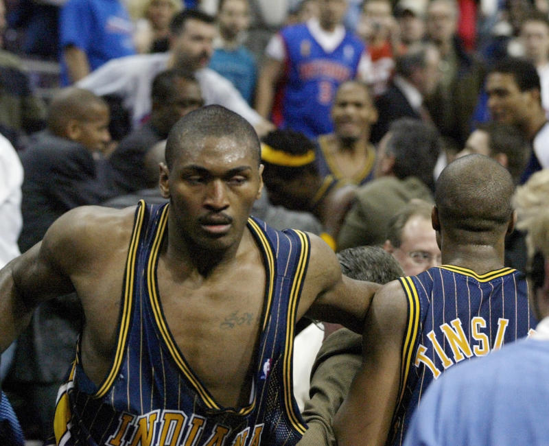 Pacers forward Ron Artest returns to the court after going into the stands to confront fans during a brawl with the Pistons on Nov. 19, 2004, in Auburn Hills, Mich. (AP Photo/Duane Burleson)