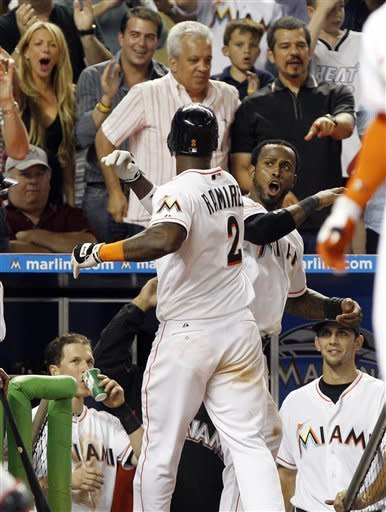 Miami Marlins' Hanley Ramirez (2) celebrates with Jose Reyes, right, after hitting a solo home run in the eighth inning of a baseball game against the Washington Nationals, Tuesday, May 29, 2012, in Miami. The Marlins defeated the Nationals 3-1 and are 20-8 since May 1. (AP Photo/Lynne Sladky)