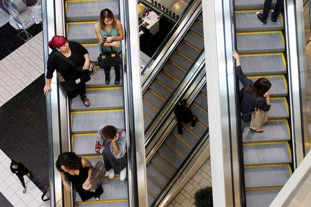 FILE PHOTO: Shoppers ride escalators at the Beverly Center mall in Los Angeles, California November 8, 2013. REUTERS/David McNew/File Photo