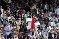 Fans cheer for Italy's Matteo Berrettini during the men's singles final match against Serbia's Novak Djokovic on day thirteen of the Wimbledon Tennis Championships in London, Sunday, July 11, 2021. (AP Photo/Alberto Pezzali)