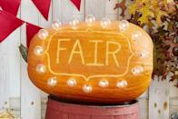 "<p>Light up the whole neighborhood with this bright and cheery marquee sign pumpkin.<strong><br></strong></p><p><strong>Make the Marquee Sign Pumpkin</strong>: Cut a large hole in the bottom of an oblong pumpkin; scoop out pulp and seeds. Carve desired word or phrase—think BOO, WELCOME, or your last name—or <a href=""https://hmg-prod.s3.amazonaws.com/files/pumpkin-carving-template-marquee-sign-1018-1536169820.pdf"" rel=""nofollow noopener"" target=""_blank"" data-ylk=""slk:download our FAIR template"" class=""link rapid-noclick-resp"">download our FAIR template</a> and trace on the long side of the pumpkin, scaling up or down as necessary. Chisel out letters and border. Remove the bulbs from a strand of globe string lights. Cut holes along the border of the chiseled area for the light sockets; insert sockets then bulbs. Plug in lights and prepare to amaze your trick-or-treaters. </p><p><a class=""link rapid-noclick-resp"" href=""https://www.amazon.com/SUNTHIN-Outdoor-Hanging-Sockets-Waterproof/dp/B07Z7HFQJT/ref=sr_1_1_sspa?tag=syn-yahoo-20&ascsubtag=%5Bartid%7C10050.g.279%5Bsrc%7Cyahoo-us"" rel=""nofollow noopener"" target=""_blank"" data-ylk=""slk:SHOP STRING LIGHTS"">SHOP STRING LIGHTS</a><br></p>"