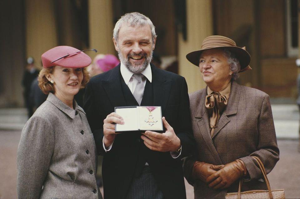 <p>Hopkins was received a CBE in 1987 (pictured here), before being knighted by Queen Elizabeth in 1993.</p>