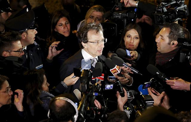 Lawyer Francesco Maresca (C) talks to the media in front of Italy's Court of Cassation palace in Rome March 27, 2015. Italy's top court on Friday annulled the conviction of American Amanda Knox for the 2007 murder of British student Meredith Kercher and, in a surprise verdict, acquitted her of the charge. The Court of Cassation threw out the second guilty verdict to have been passed on Knox, 27, and her Italian former boyfriend Raffaele Sollecito for the lethal stabbing. REUTERS/Remo Casilli
