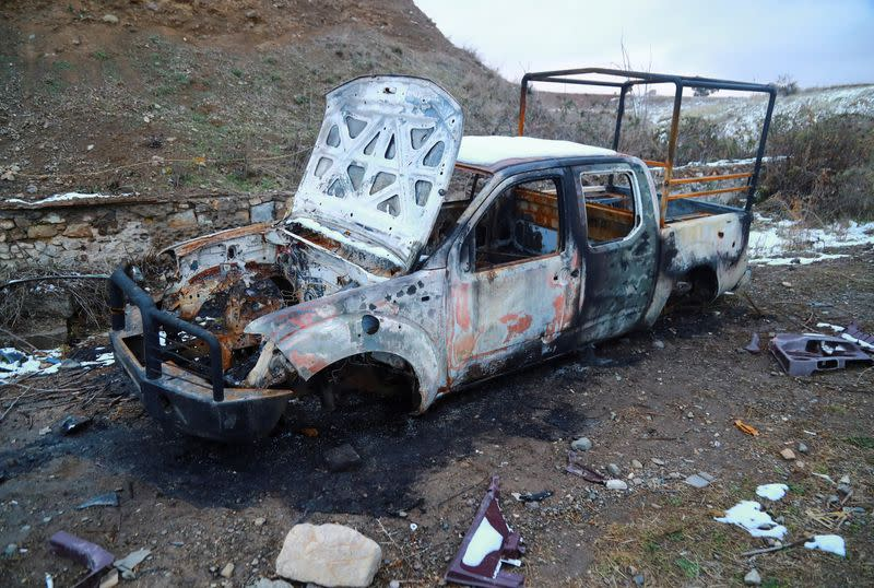 FILE PHOTO: A view shows a burnt vehicle in Jabrayil District