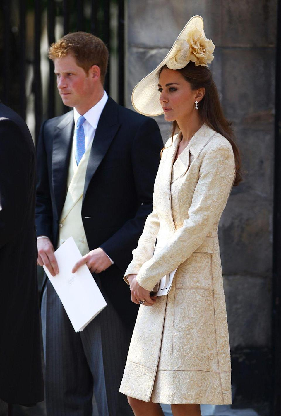 <p>For another in-law wedding (the union of Zara Phillips and Mike Tindall) in Scotland, Kate brought back the Day Birger et Mikkelsen, but opted to go with a giant potato chip flower hat. </p>