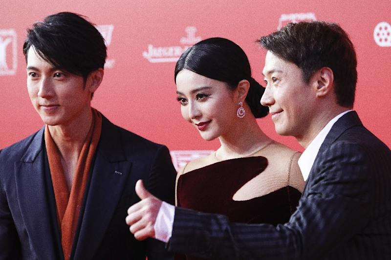 This photo taken on June 13, 2015 shows (L to R) Taiwanese actor Wu Chun, Chinese actress Fan Bingbing and Hong Kong actor and Cantopop singer Leon Lai arriving on the red carpet for the opening ceremony of Shanghai International Film Festival (AFP Photo/)