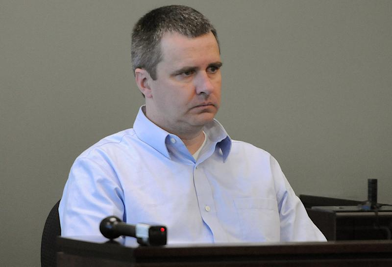 Thomas Mortimer IV is seated during his hearing at Middlesex Superior Court in Woburn, Mass., Wednesday Oct. 3, 2012. Mortimer plead guilty to the first-degree murder of his wife, mother-in-law and two young children after an argument over a bounced check. He was sentenced to life in prison without the possibility of parole. (AP Photo/Boston Herald, Patrick Whittemore, POOL)