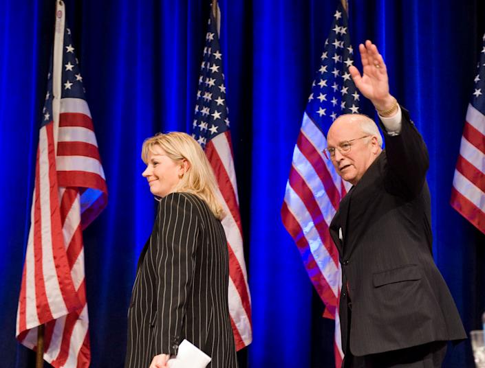 Liz Cheney, board member, Keep America Safe, walks off the stage with her father, former Vice President Dick Cheney, after they addressed the Conservative Political Action Conference (CPAC), in Washington, Thursday, Feb. 18, 2010. (AP Photo/Cliff Owen)