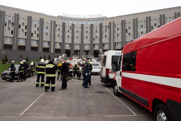 PHOTO: Russian emergency workers attend the scene of a fire at St. George Hospital in Saint Petersburg, Russia, on May 12, 2020. Russian state media reported that the blaze killed five coronavirus patients who had been put on ventilators at the hospital. (Dmitry Lovetsky/AP)