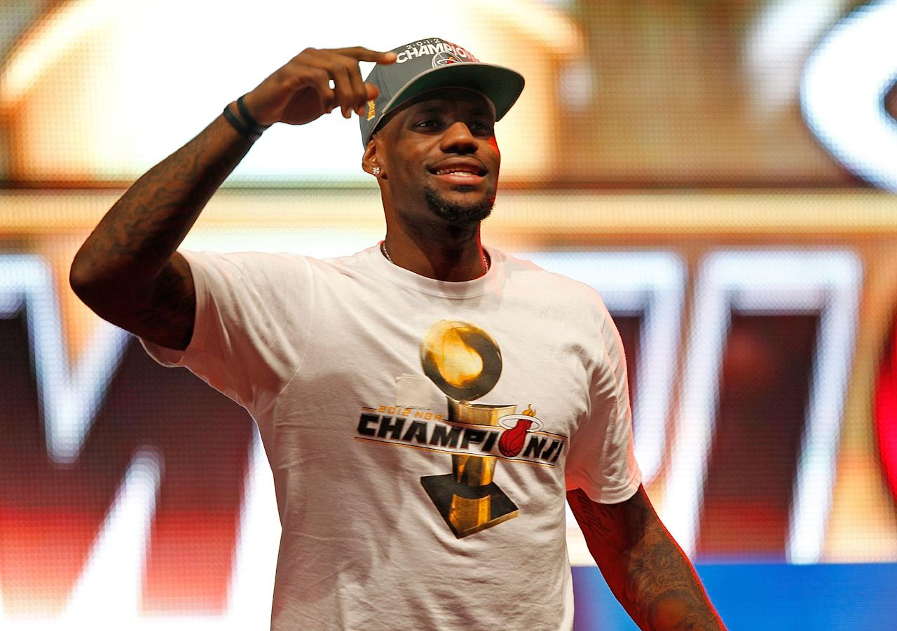 MIAMI, FL - JUNE 25:  LeBron James #6 of the Miami Heat celebrates during a rally for the 2012 NBA Champion Miami Heat at American Airlines Arena on June 25, 2012 in Miami, Florida.  (Photo by Mike Ehrmann/Getty Images)
