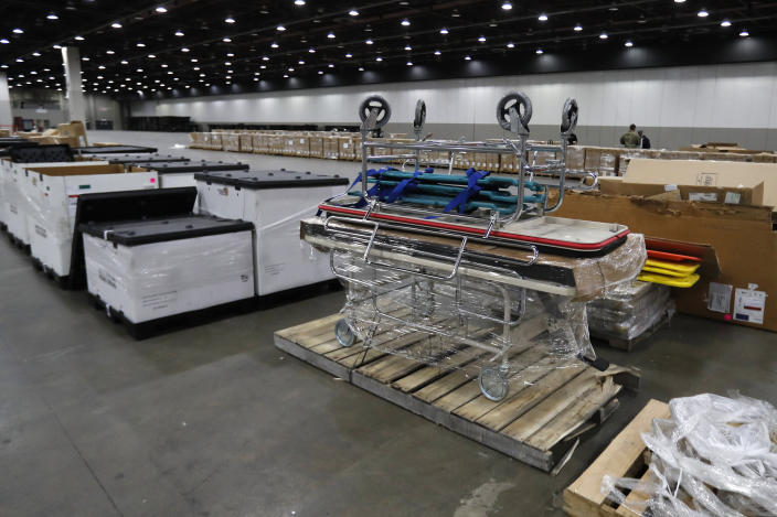 In this April 1, 2020, photo basic stretchers are seen at the TCF Center in Detroit. In the decade before Michigan and its largest city became the latest hotspot for the deadly coronavirus, officials were steadily cutting back on their first line of defense against pandemics and other health emergencies. Approaching bankruptcy, Detroit disbanded most of its public health department and handed its responsibilities to a private nonprofit. (AP Photo/Carlos Osorio)