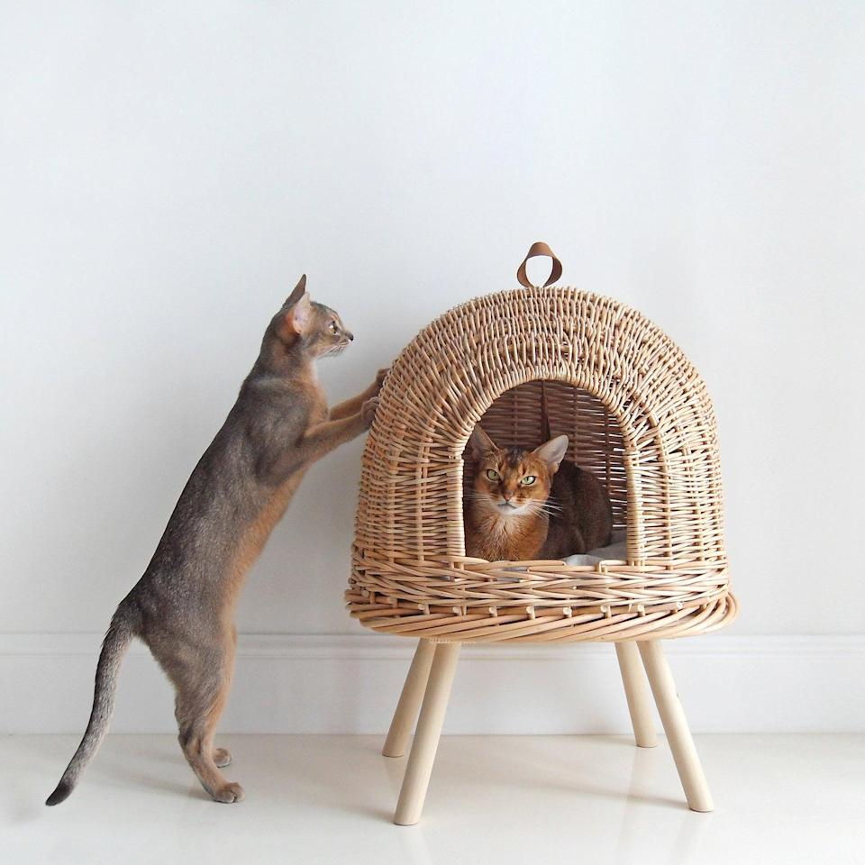 """<p>If your cat is more comfortable sleeping off the ground, consider a chic, pedestal-style bed. Composed of handwoven wicker, this cube-shaped den is upright on a set of wooden peg legs, and comes with a leather toy tassel on the interior and a linen pillow to boot—perfect for those with more than one feline at home.</p> <p><strong><em>Shop Now:</em></strong><em> Hunting Pony Natural Wicker Cat Bed, $295, <a href=""""https://www.awin1.com/cread.php?awinmid=6220&awinaffid=272513&clickref=MSL10ModernCatBedsforaWellDesignedHomeaharperCatGal7985721202010I&p=https%3A%2F%2Fwww.etsy.com%2Flisting%2F603884496%2Fvine-cat-bed-house-for-cats-wicker-house"""" rel=""""nofollow noopener"""" target=""""_blank"""" data-ylk=""""slk:etsy.com"""" class=""""link rapid-noclick-resp"""">etsy.com</a></em><em>.</em></p>"""