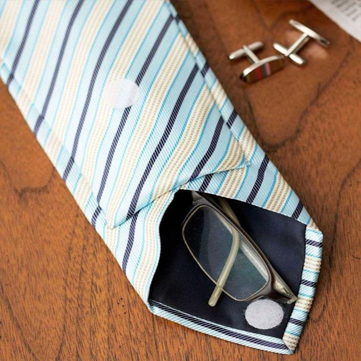 """<p>Giving Dad a tie for Father's Day is so last year. Mix things up this time around and transform an old tie into a convenient carrying case for eyeglasses so he doesn't lose them as easily.</p><p><em>Get the tutorial at <a href=""""https://www.countryliving.com/diy-crafts/g1171/gift-ideas-for-dad/"""" rel=""""nofollow noopener"""" target=""""_blank"""" data-ylk=""""slk:Country Living"""" class=""""link rapid-noclick-resp"""">Country Living</a>.</em><em><br></em></p>"""